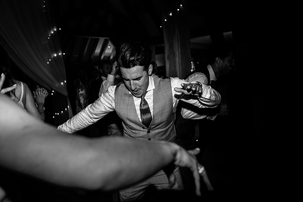 guest dancing at The old Kent Barn wedding