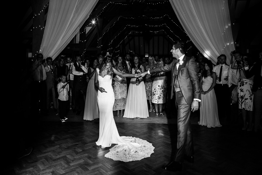 Black and white shot of the first dance at The old Kent Barn wedding