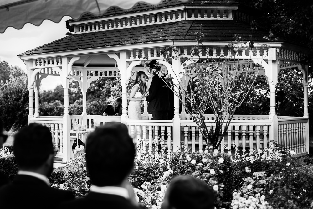 black and white shot of laughing bride at The old Kent Barn