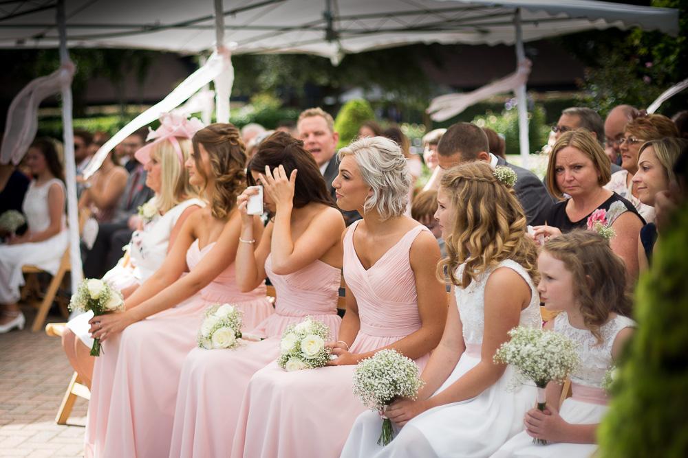 beautiful bridesmaid wearing pink dresses and crying at The old Kent Barn