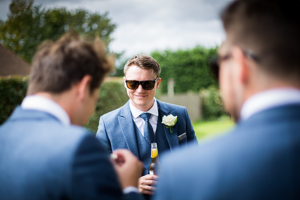 Best man drinking a beer at The old Kent Barn