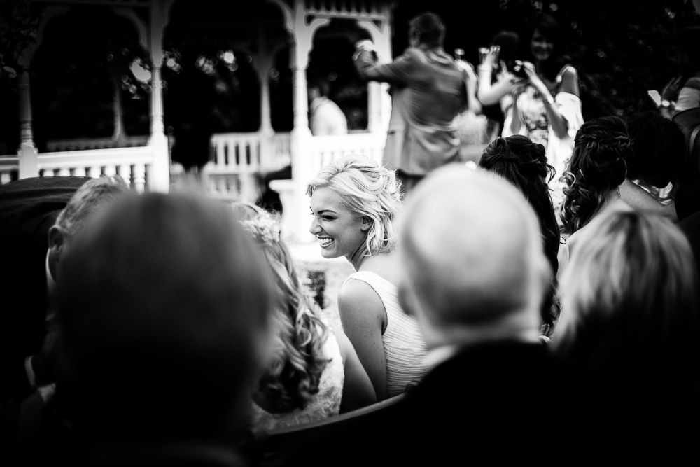 pretty smiling bridesmaid in black and white