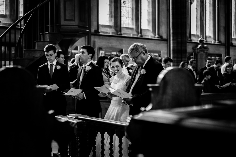 bride tenderly looking at her groom at the altar