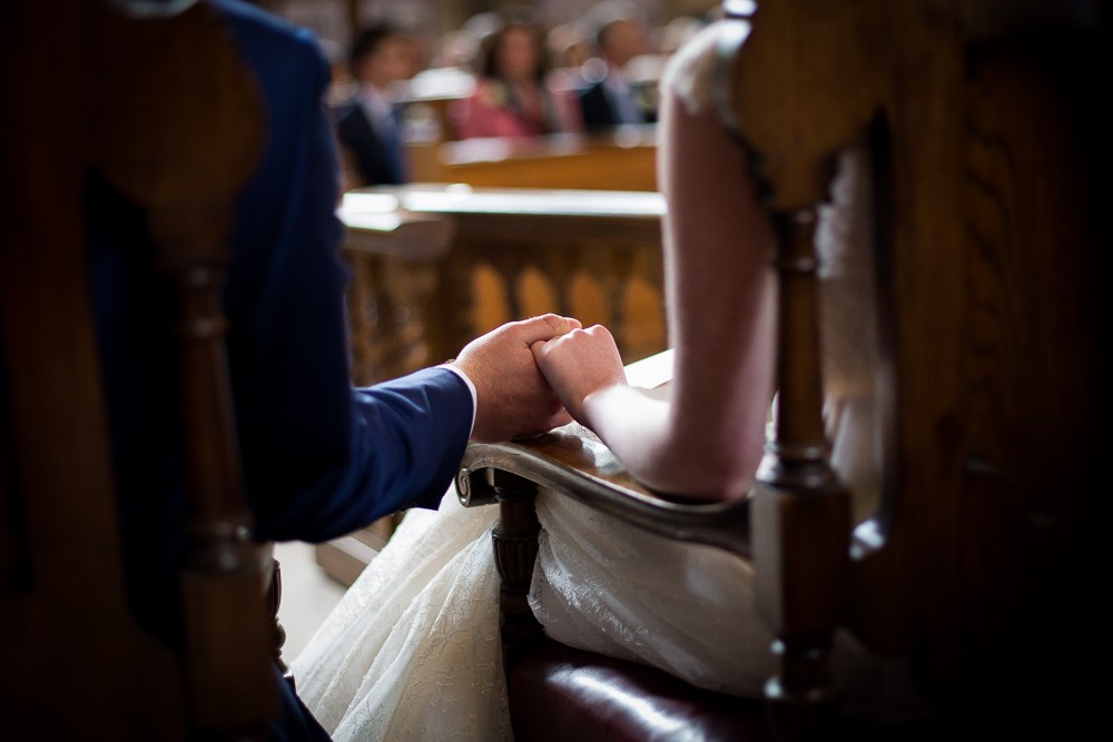 bride and groom holding hand shot