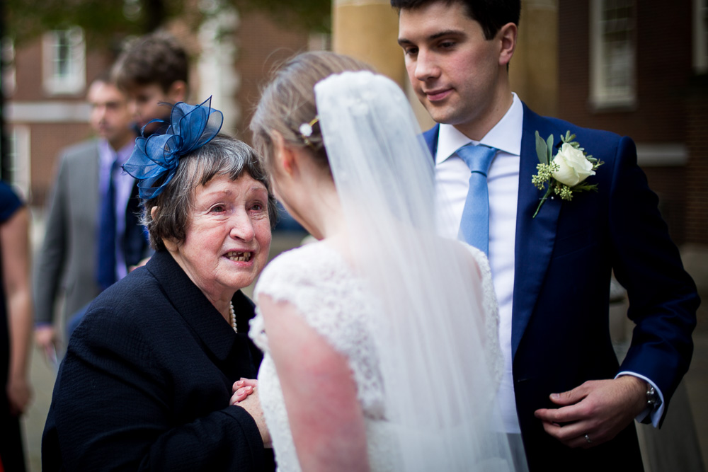 grandmother congratulating her grandaughter on her wedding day