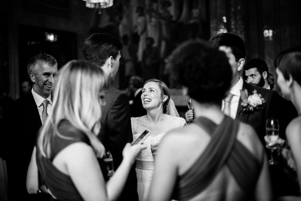 laughing bride looking at her groom