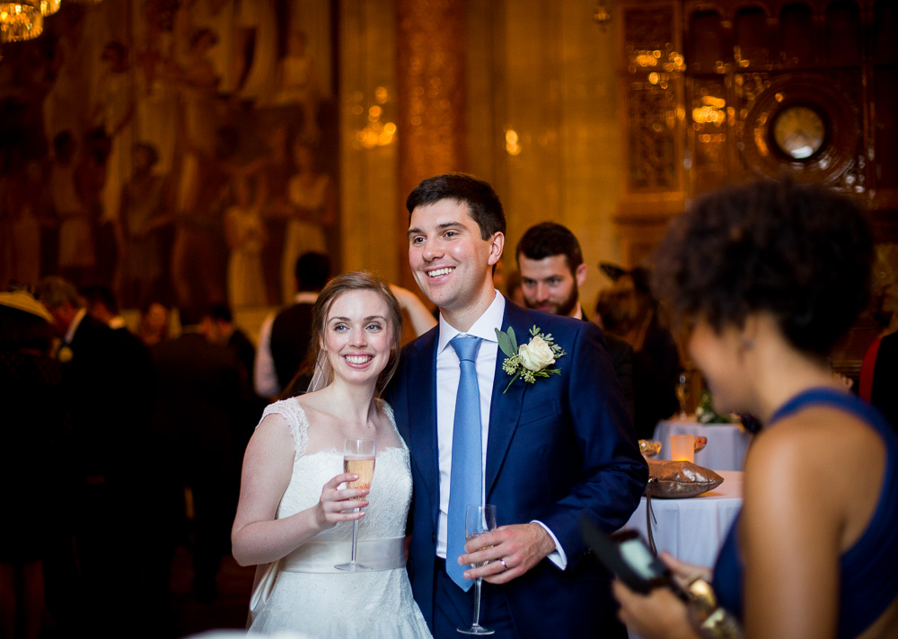 happy bride and groom laughing at One whitehall place