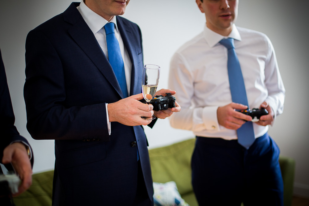 groom and best man playing video games in London
