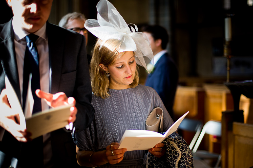 thoughtful wedding guest at the church reading
