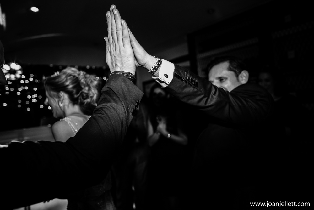high five in black and white