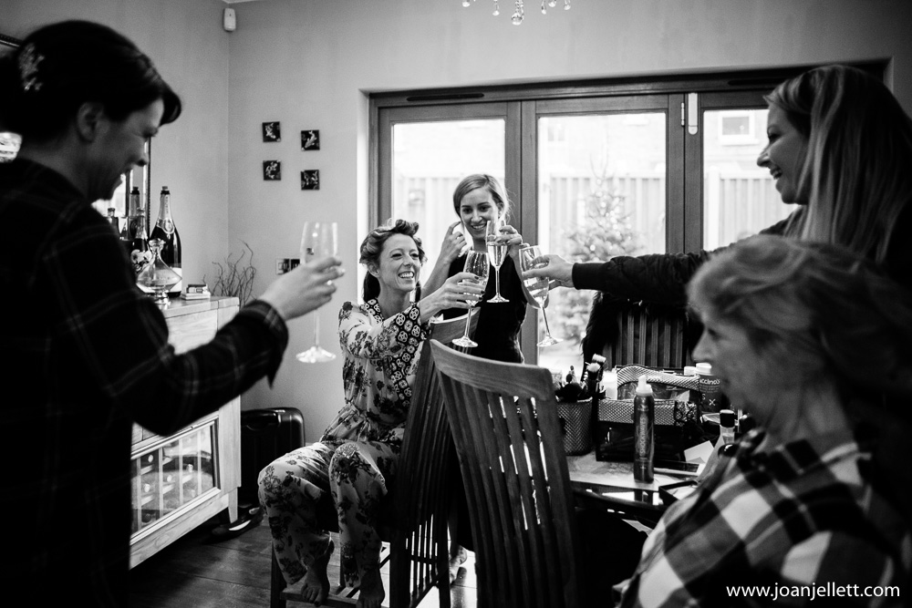 cheers in black and white of bride and bridal party