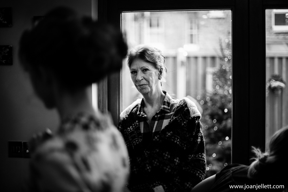 mother of the bride looking at her daughter in black and white