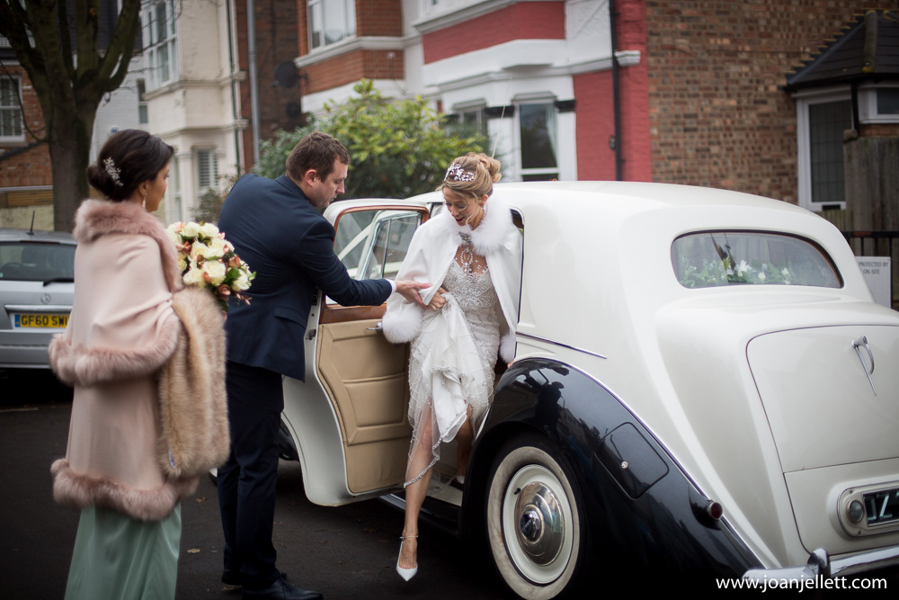 bride getting out of her Bentley in Petersham hotel car park