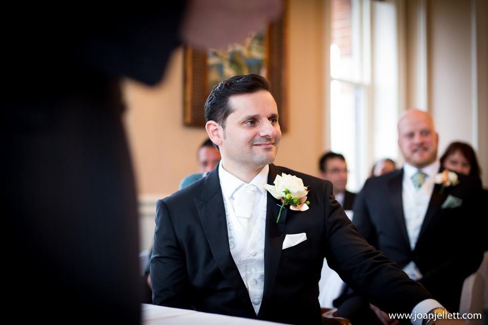 groom smiling in Petersham Hotel