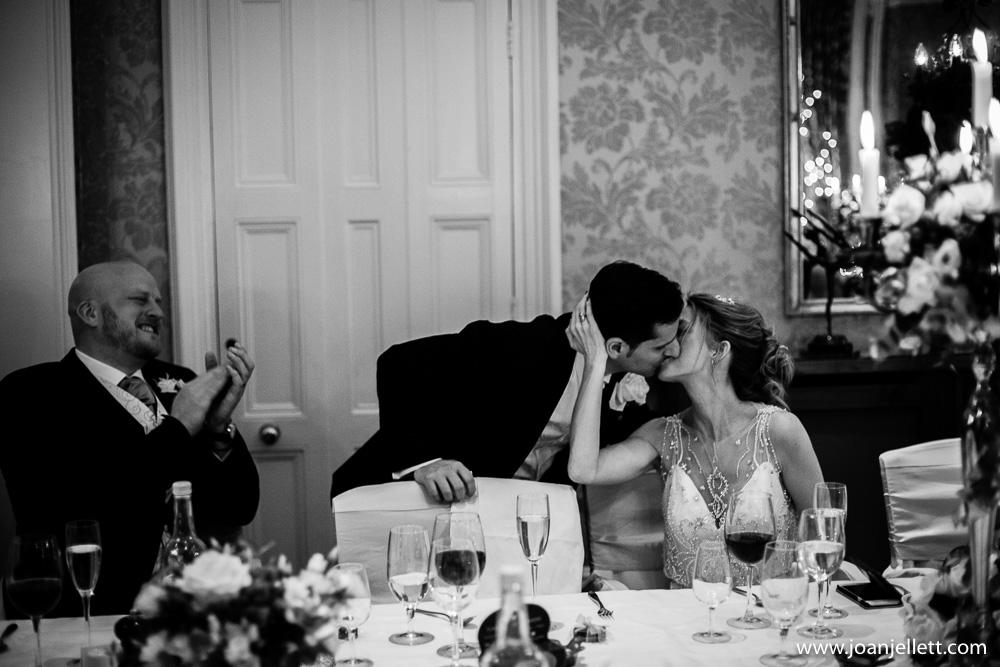 Bride kissing her groom tenderly