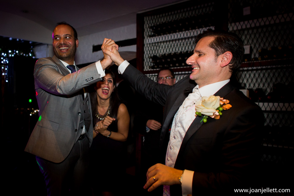 best man holding hand with groom