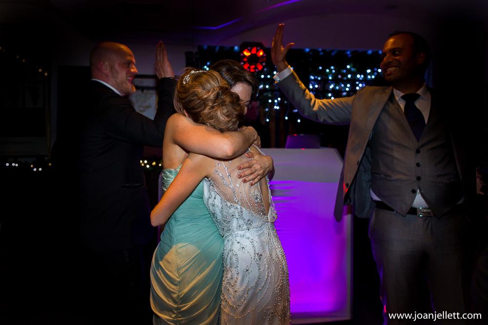 bride hugging bridesmaid