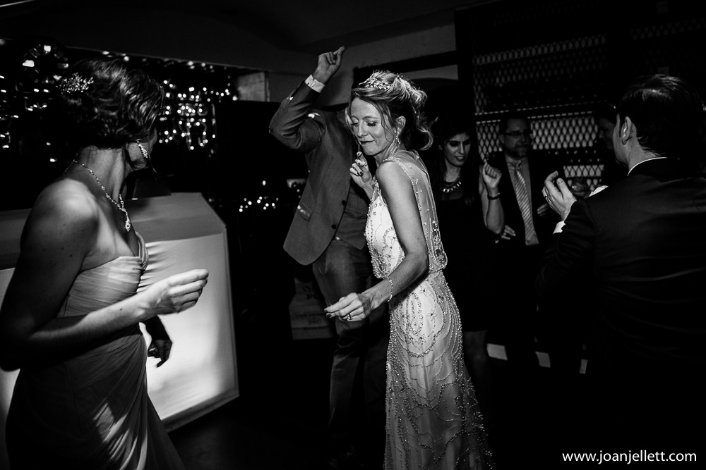 black and white shot of bride dancing