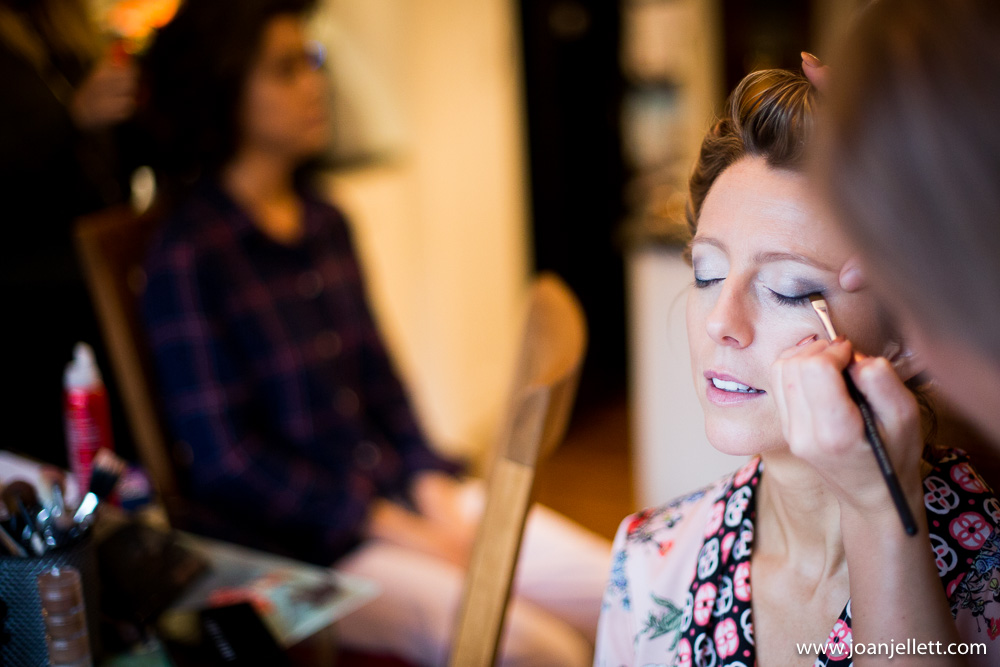bride eyes closed having her makeup done