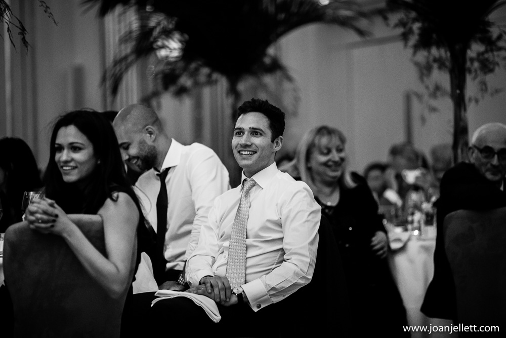 guest smiling during the speeches in claridge's