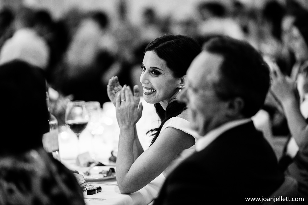 bride laughing and looking at her groom