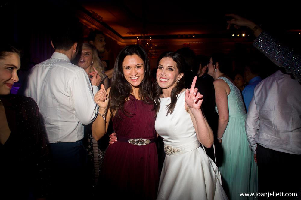 bride with best friend on the dance floor
