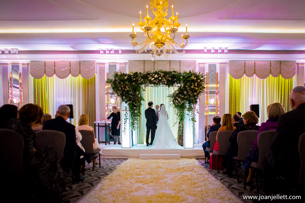 bride saying her vows in Claridge's