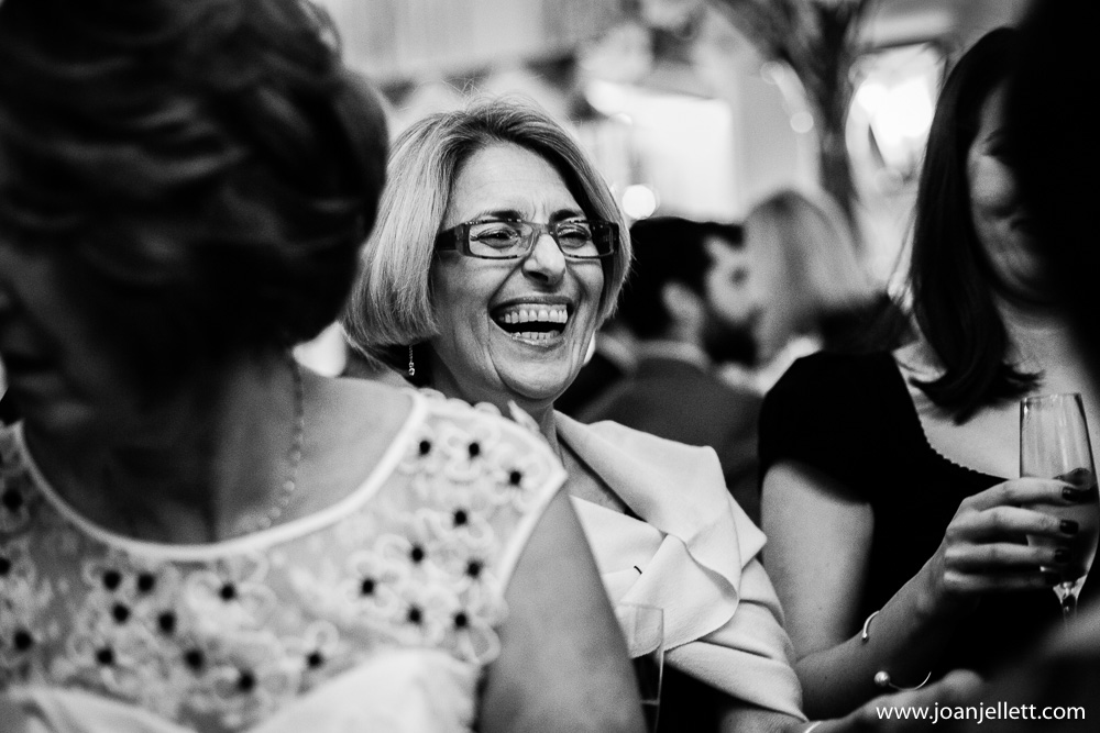 guest laughing in black and white