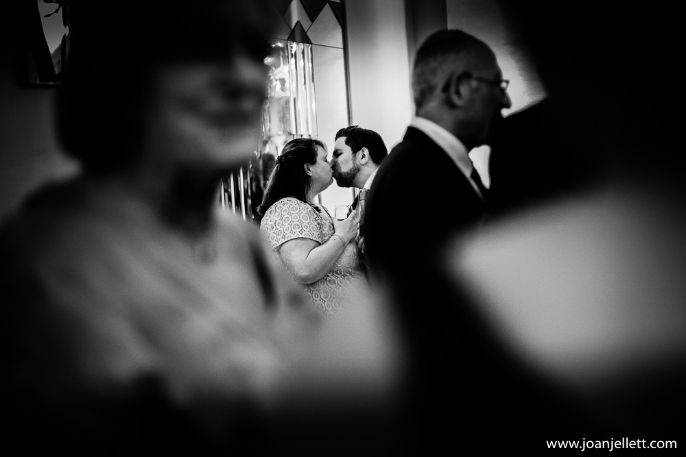 kissing couple in black and white in claridge's