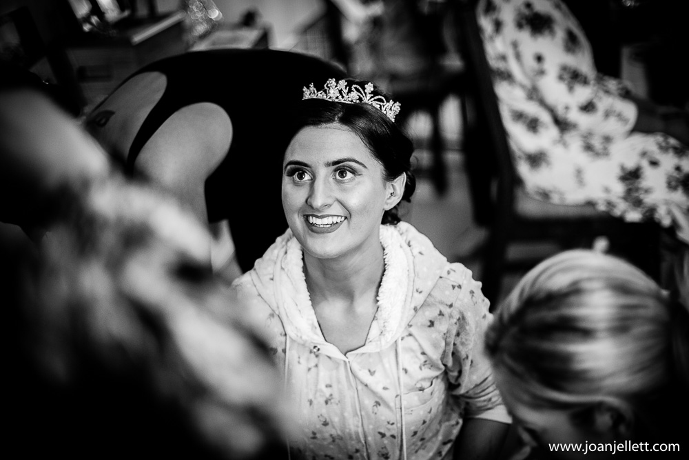 black and white shot of bride smiling
