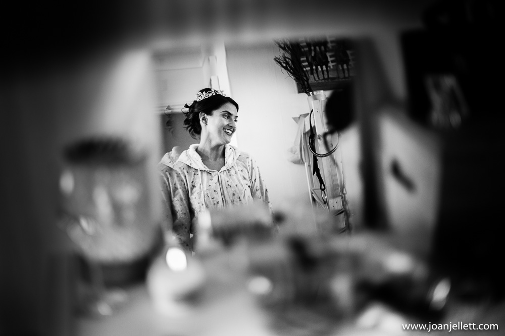 black and white shot of bride laughing