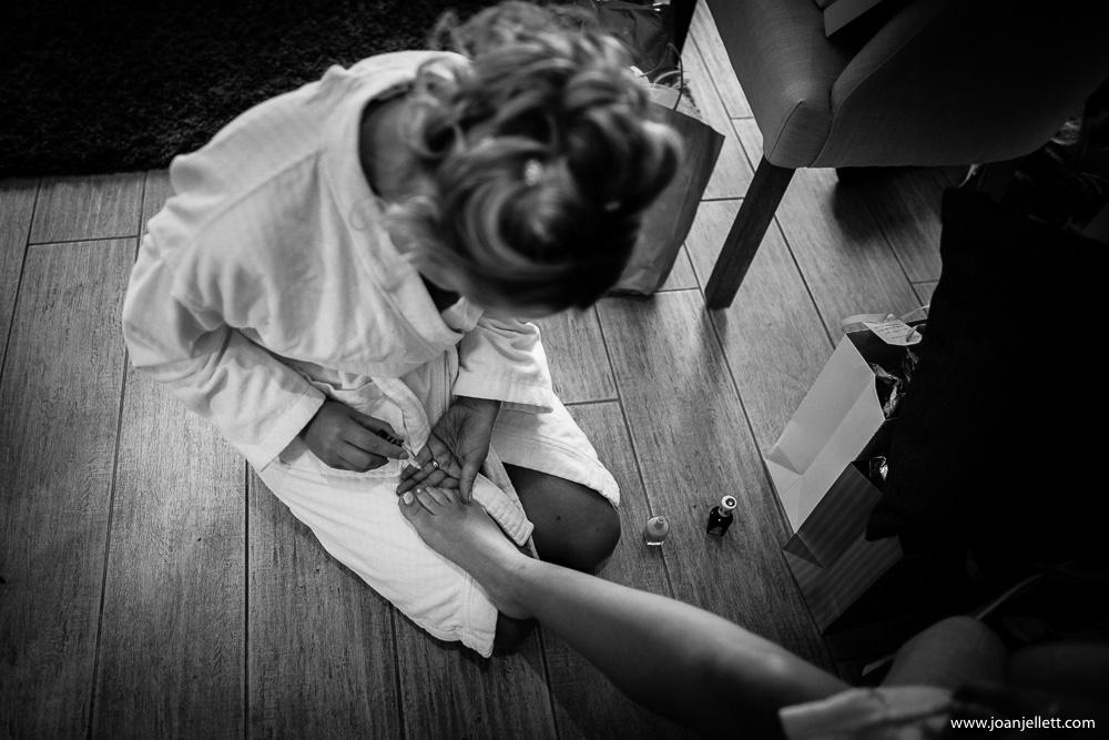 bridesmaid painting her nails