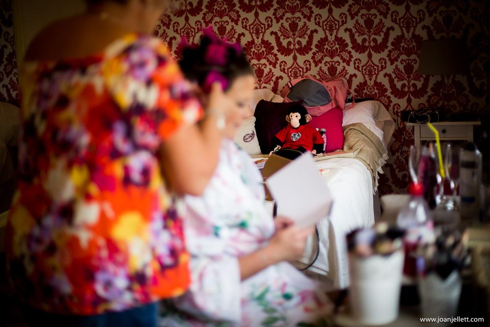 bride during bridal preparation at milling barn