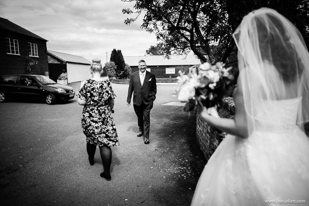 father of the bride arriving at milling barn