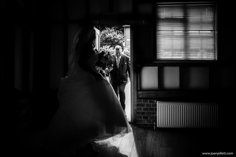 father of the bride entering the reception room
