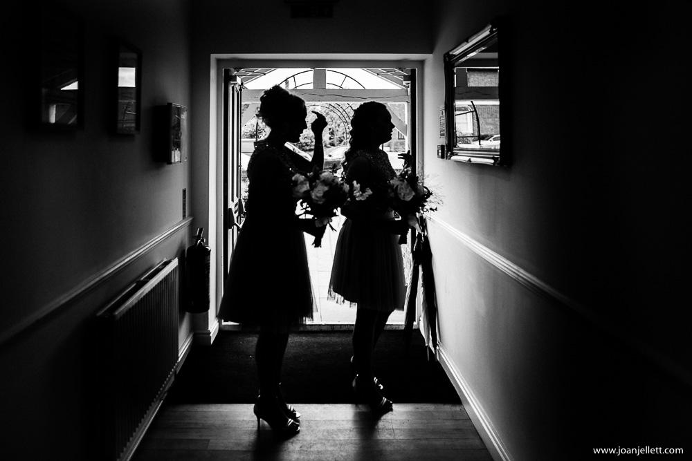 shadows of bridesmaid looking at the mirror