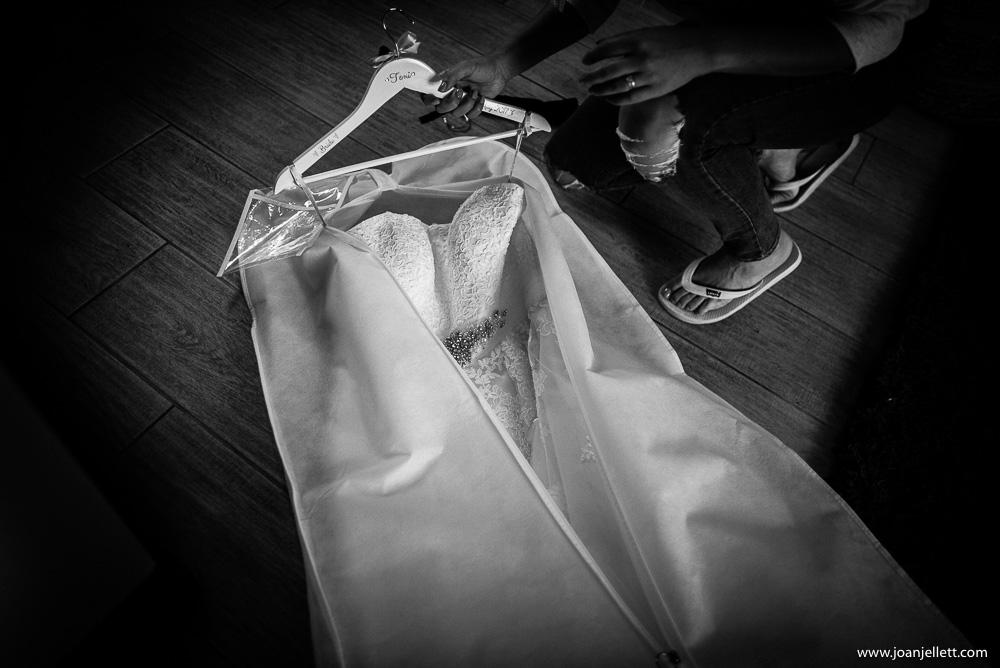 black and white shot of wedding dress at milling barn