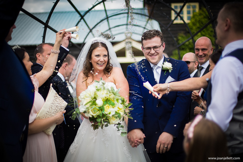 confetti shot of the bride and groom