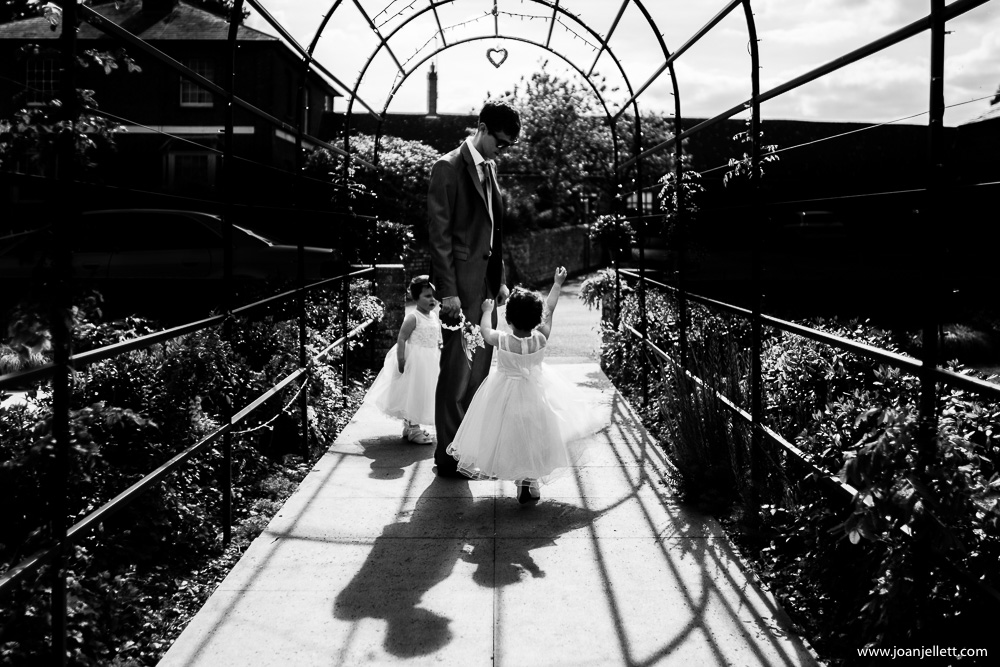 black and white shot of dad and daughters