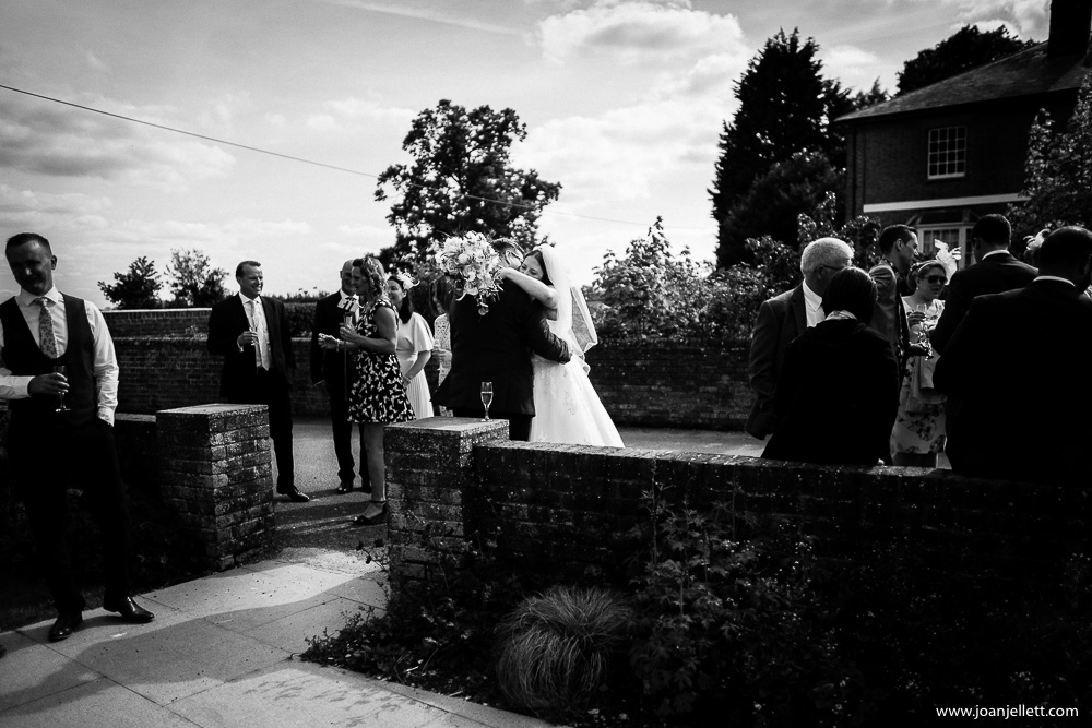 kissing bride and groom black and white