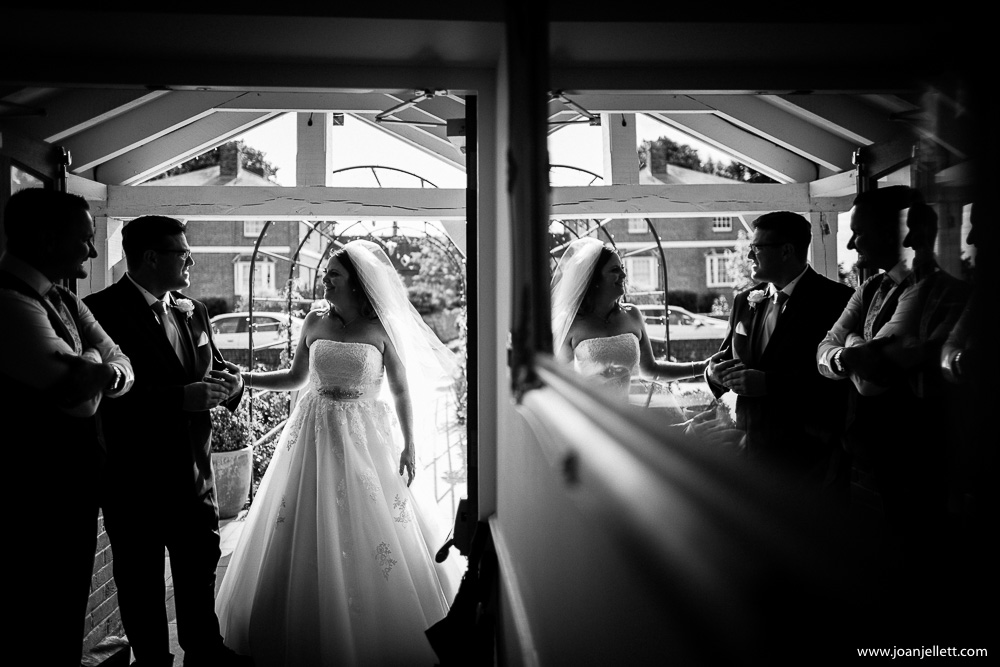 reflection of the bride and groom in the mirror