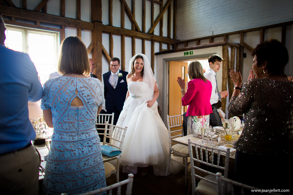 bride entering in the barn for the wedding breakfast