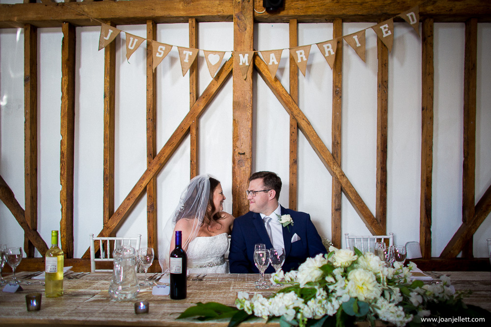 milling barn wedding photography of bride and groom