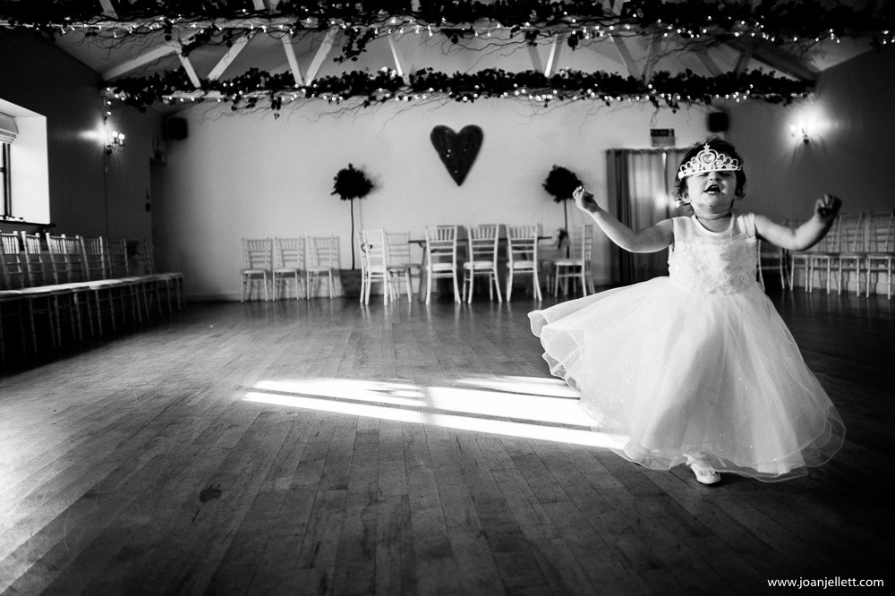 little girls running around with a tiara