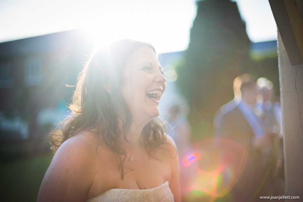 laughing bride in the sun