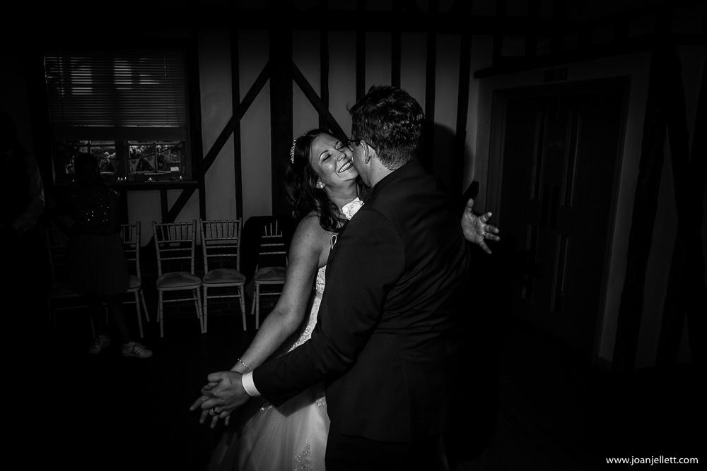 bride dancing wth her husband