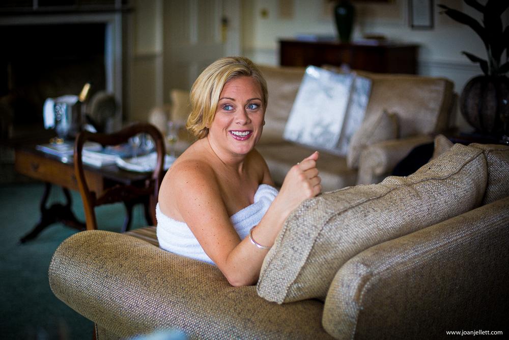 bridesmaid laughing on the sofa at the Luton Hoo