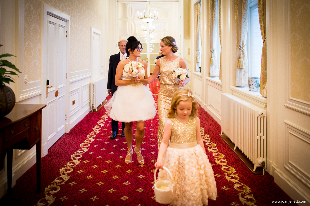 bride and her party walking down the hall