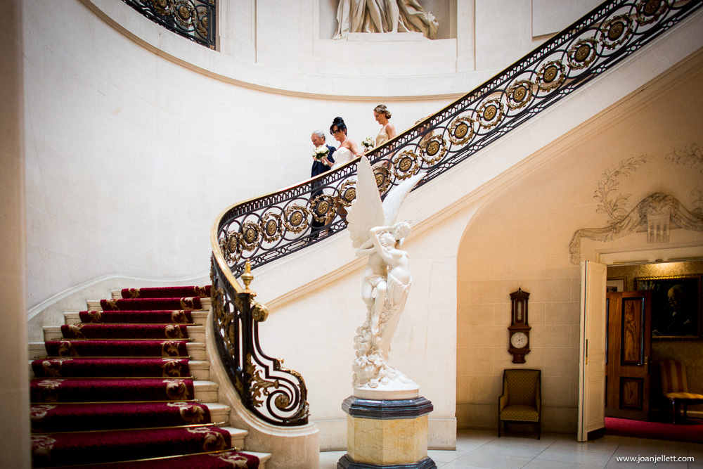 bride walking down the stairs at the Luton Hoo