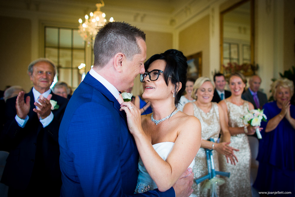 bride kissing her groom at the Luton hoo